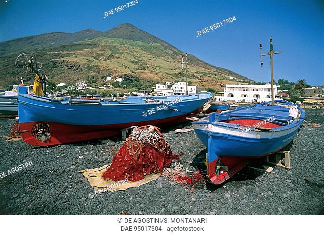 Fishing boats docked on dry land in Scari port, Stromboli, Aeolian islands, Sicily, Italy