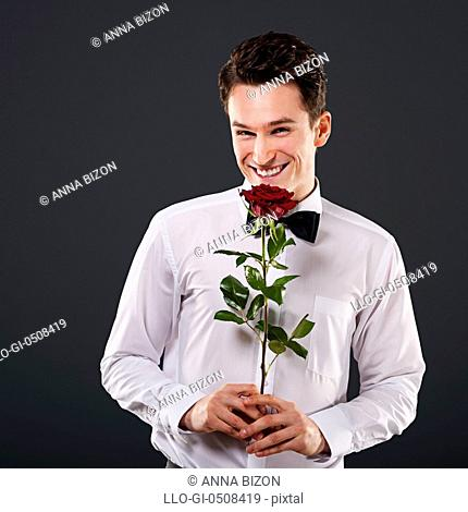 Smiling man with red rose Debica, Poland
