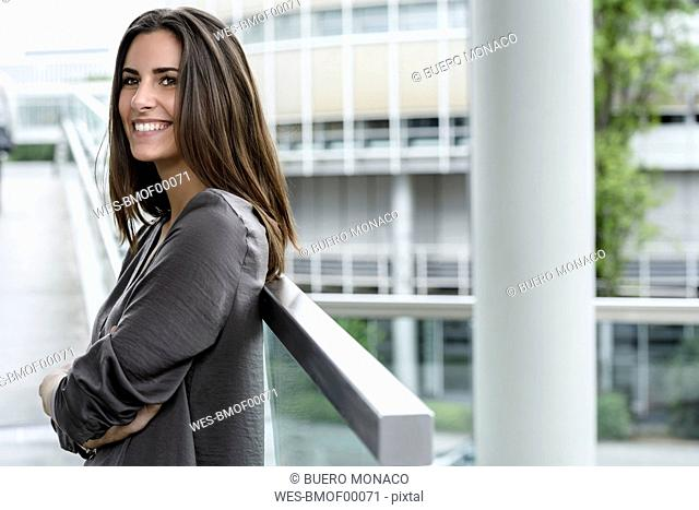 Smiling young businesswoman looking at distance