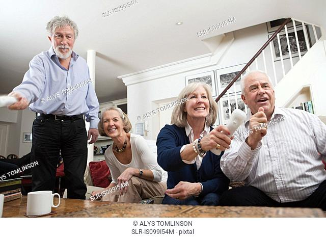 Senior friends playing video game