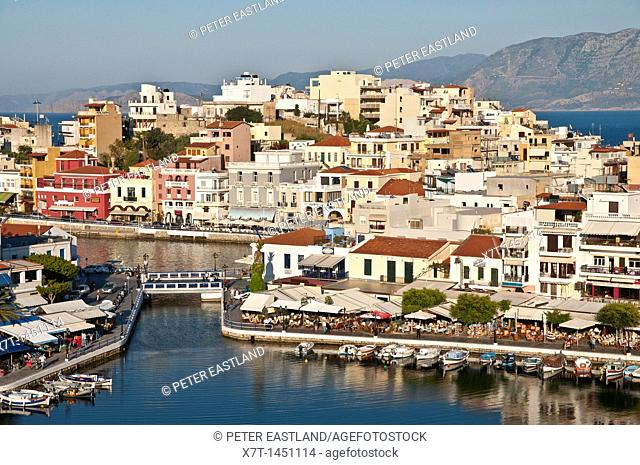 Looking down on the inner lake and outer harbour at Agios Nikolaos in Eastern Crete, Greece