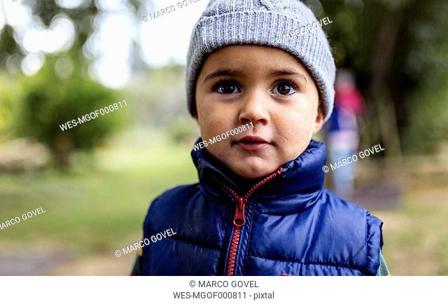 Portrait of little boy wearing woolly hat and waistcoat