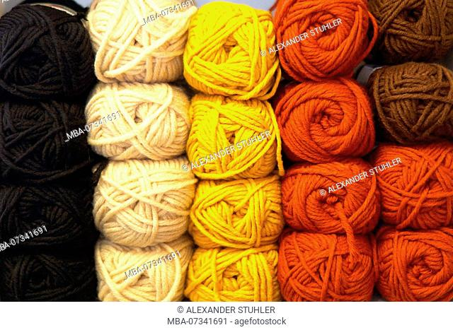 A stack balls of wool in different colours