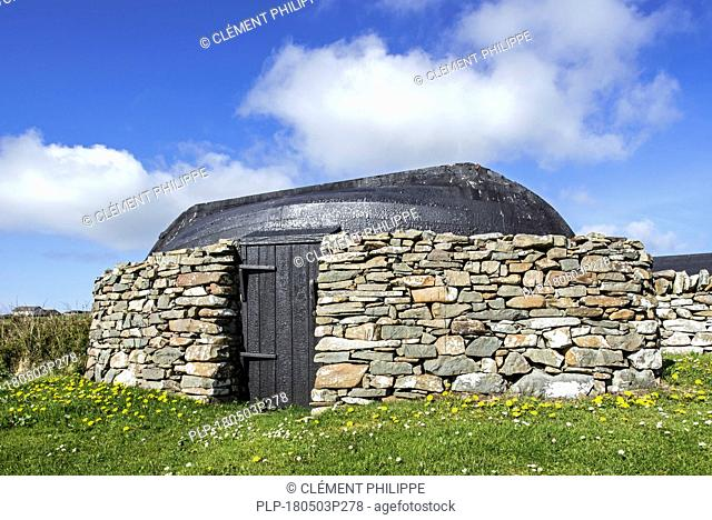 Boat-roofed shed at the Croft House Museum / Crofthouse Museum, restored straw-thatched cottage at Boddam, Dunrossness, Shetland Islands, Scotland, UK