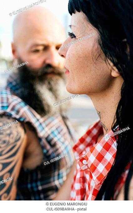 Profile portrait of mature hipster woman with boyfriend