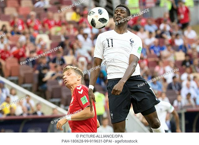 26 June 2018, Russia, Moscow, Soccer, FIFA World Cup 2018, Group C, Matchday 3 of 3 at Luzshniki Stadium: Jens Stryger Larsen (L) from Denmark and Ousmane...