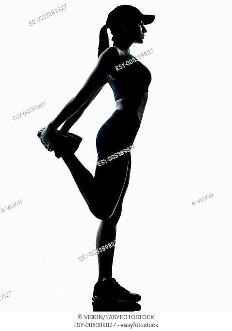 one caucasian woman runner jogger stretching legs in silhouette studio isolated on white background