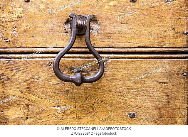 Close up of rustic old door in Spoleto, Italy