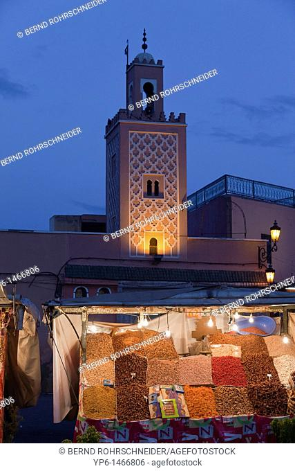 mosque and market stand at dusk, Djemaa el Fna, Marrakesh, Morocco