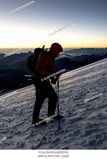 Russia, Upper Baksan Valley, Caucasus, Mountaineer ascending Mount Elbrus