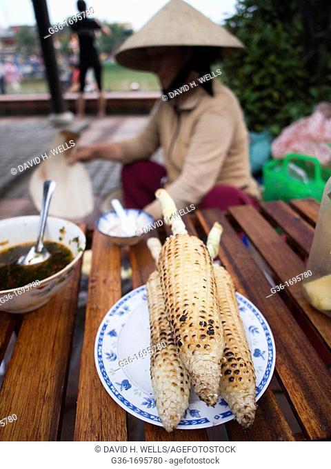 Street food vendor at work on streets of Hoi An, Vietnam