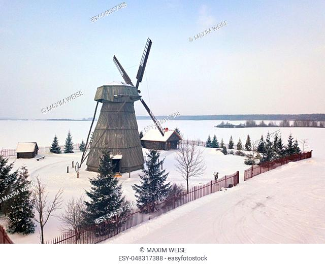 Authentic wooden windmill at winter season. Aerial view of landmark Dudutki in Belarus