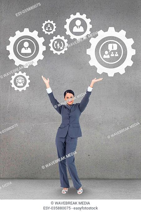 Business woman interacting with people in cogs graphics against grey background