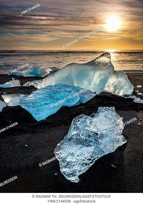 Ice on black sands. Ice formations come from the Jokulsarlon Glacial Lagoon, Breidamerkurjokull Glacier, Vatnajokull Ice Cap, Iceland