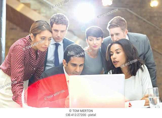 Business people working at laptop in office