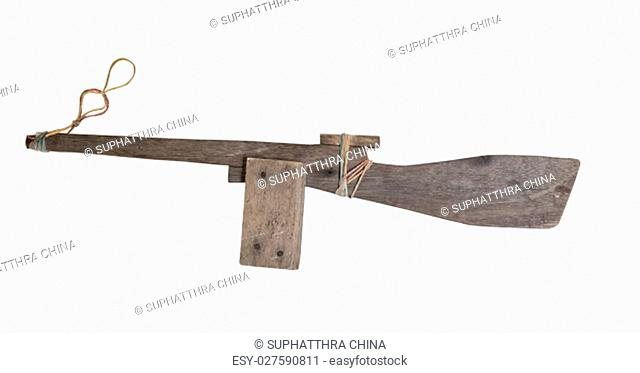 Wooden gun toy isolated on white background with clipping path