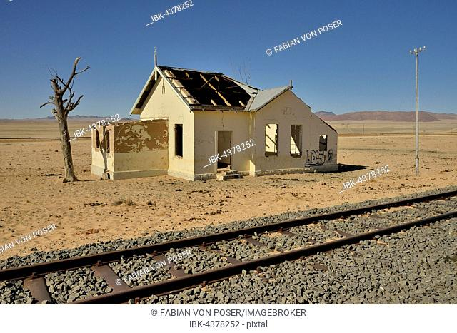 Derelict house next to train tracks, former railway station of Garub, Aus, Karas Region, Namibia