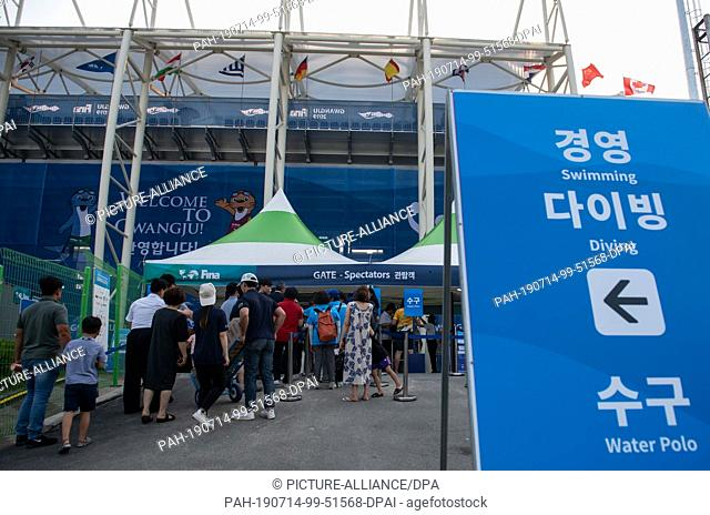 14 July 2019, South Korea, Gwangju: Swimming World Championship: Spectators are waiting for admission in front of the water polo stadium