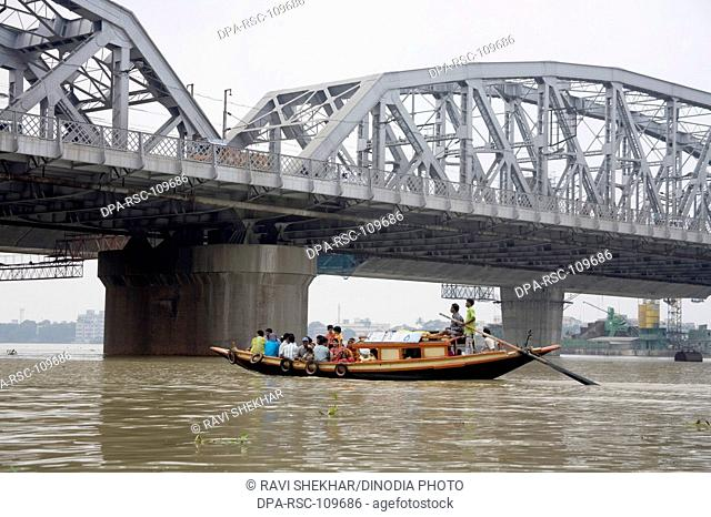 Boating ; Dakshineshwar Hooghly river Bridge ;  Calcutta Kolkata ; West Bengal ; India