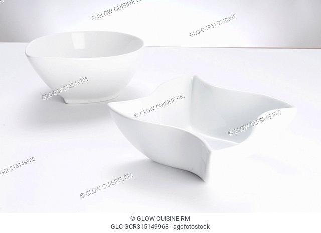 Close-up of two white ceramic bowls
