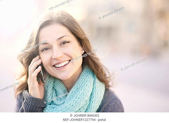 Portrait of young woman talking on cell phone