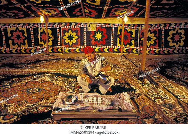 Serving Traditional Sour Coffee in Traditional Bedouin Tent Dubai, United Arab Emirates, Middle East