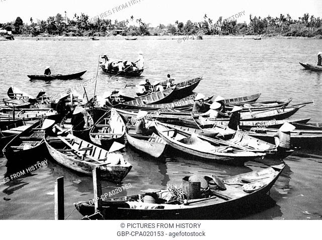 Vietnam: Boats at the pier on the Thu Bon River, Hoi An (1950)