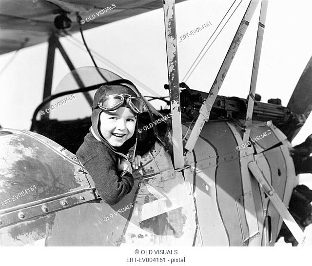 Little boy in cockpit of plane All persons depicted are not longer living and no estate exists Supplier warranties that there will be no model release issues