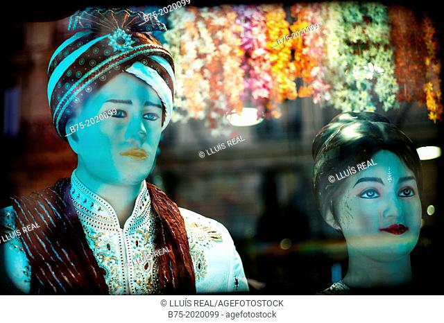 Two mannequins in the shop window of a Hindu fashion store in a suburb of Paris, France, Europe