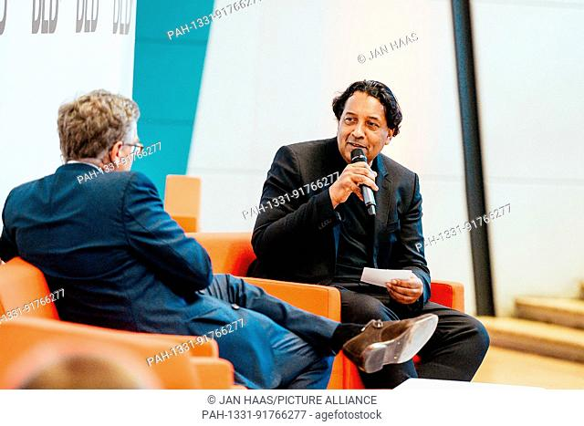 BAYREUTH/GERMANY - JUNE 21: Stefan Winners (Hubert Burda Media, l.) talks with Cherno Jobatey (Huffington Post) on the stage during the DLD Campus event at the...