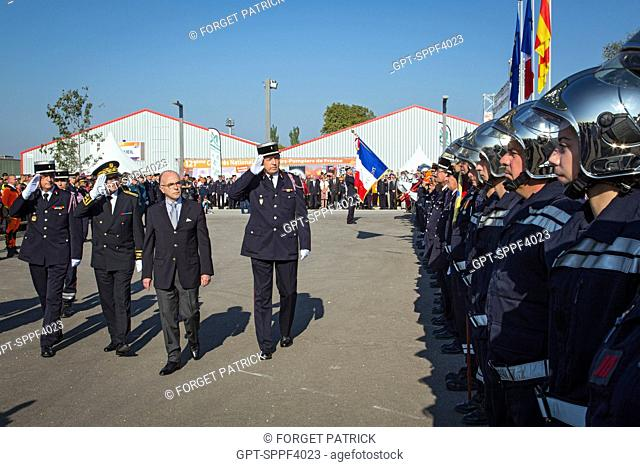 REVIEW OF THE TROOPS WITH THE MINISTER OF THE INTERIOR BERNARD CAZENEUVE AND ERIC FAURE, PRESIDENT OF THE FNSPF, NATIONAL CONGRESS OF FRENCH FIREFIGHTERS