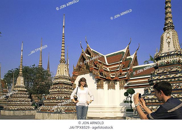 Thailand, Bangkok, Tourist Couple Taking Photos in Wat Po