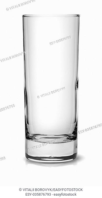 Empty tall narrow glass isolated on white background