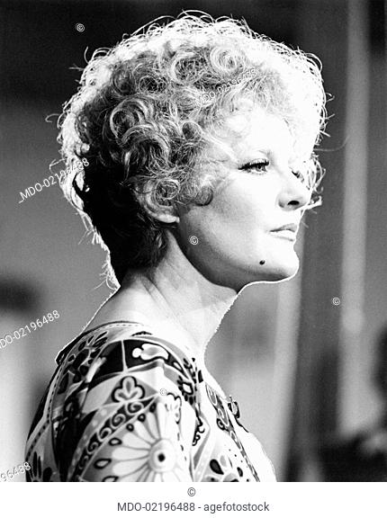 Portrait in profile of the British actress Petula Clark wearing a decorative motifs dress. Milan (Italy), May 1968