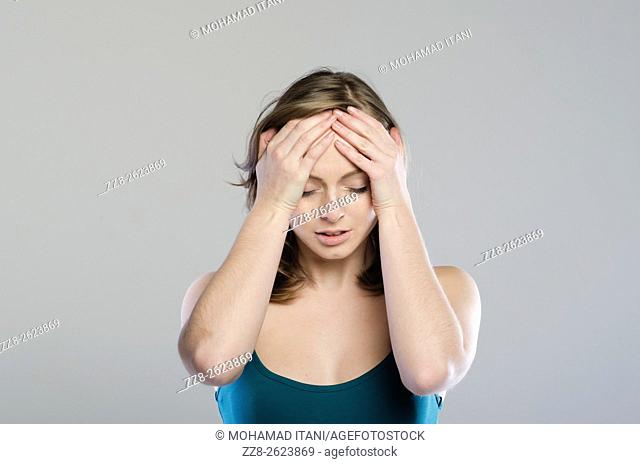 Woman head inhands with a headache