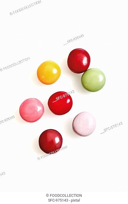 Coloured chewing gum pellets overhead view