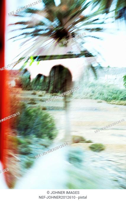 Blurred view of river seen through window