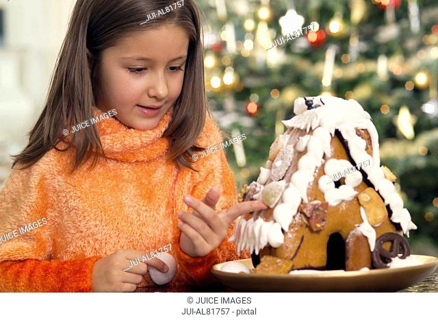 Girl with gingerbread house on Christmas