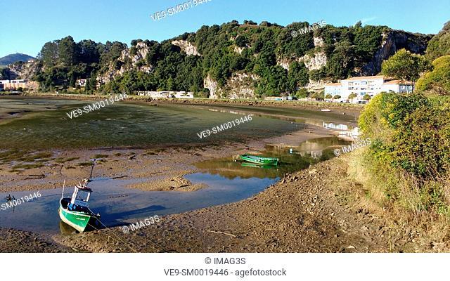 Sella river and Tito Bustillo cave entrance in background. Ria of Ribadesella. Asturias. Spain