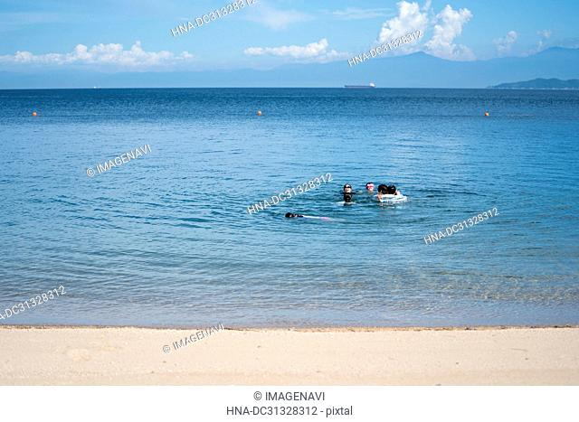 Girls Swimming in Beach