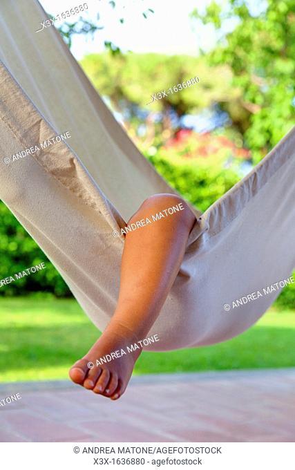 Small child leg over hammock