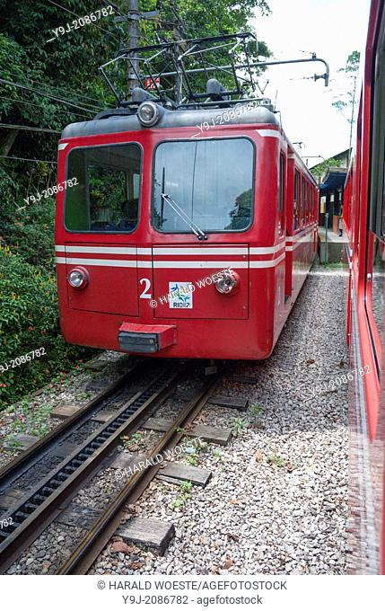 """""""Rio de Janeiro, Brazil: The famous train """"""""""""""""Trem do Corcovado"""""""""""""""" travelling up to the mountain top of Corcovado with it's christ statue Cristo Redentor"""