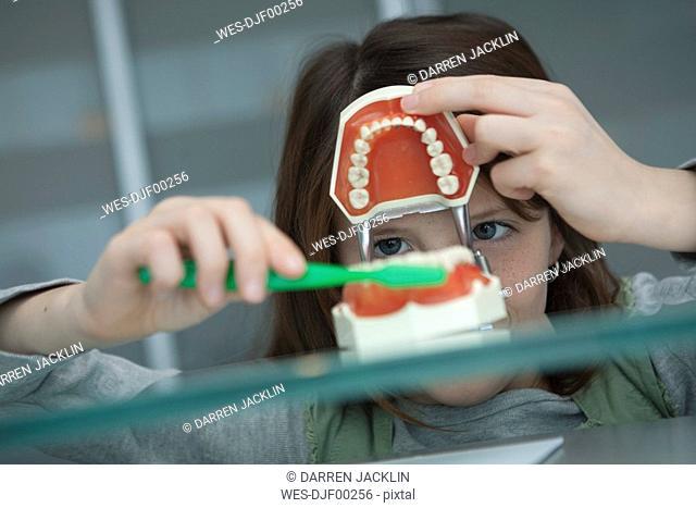 Germany, Bavaria, Landsberg, Girl 8-9 in dental surgery