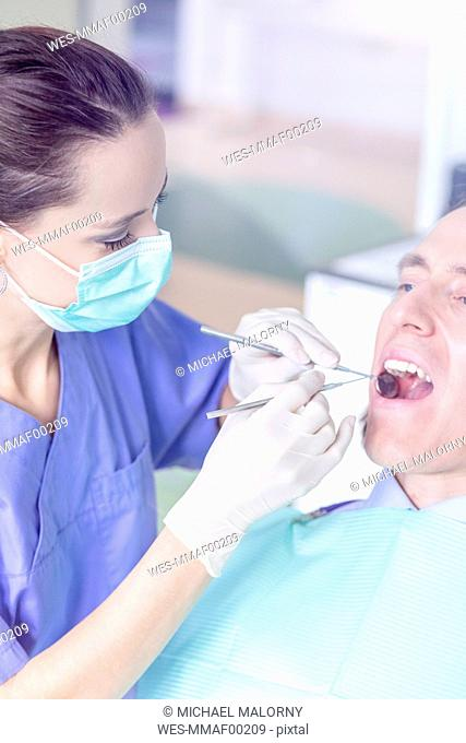 Patient receiving treatment at the dentist