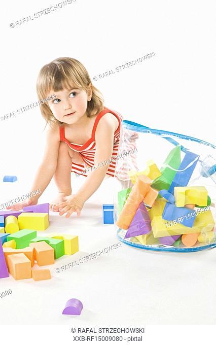 baby tidy up bricks into bag