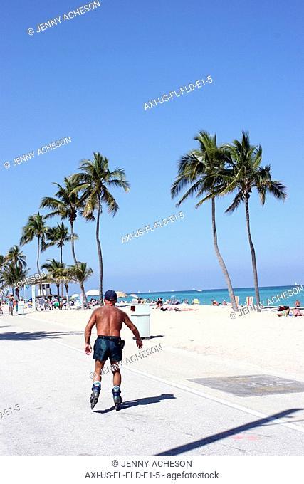 Man inline skating on promenade, FortLauderdale, Florida, USA