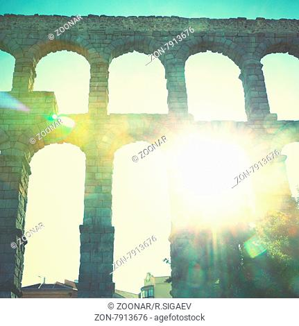 Ancient Roman aqueduct in Segovia, Spain. Retro style filtered image
