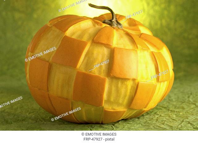 Pumkins with a carved pattern