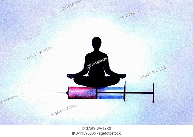Woman in lotus position on hypodermic needle