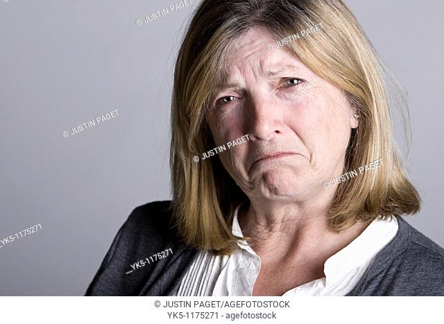 Powerful Shot of a Sad Looking Senior Lady